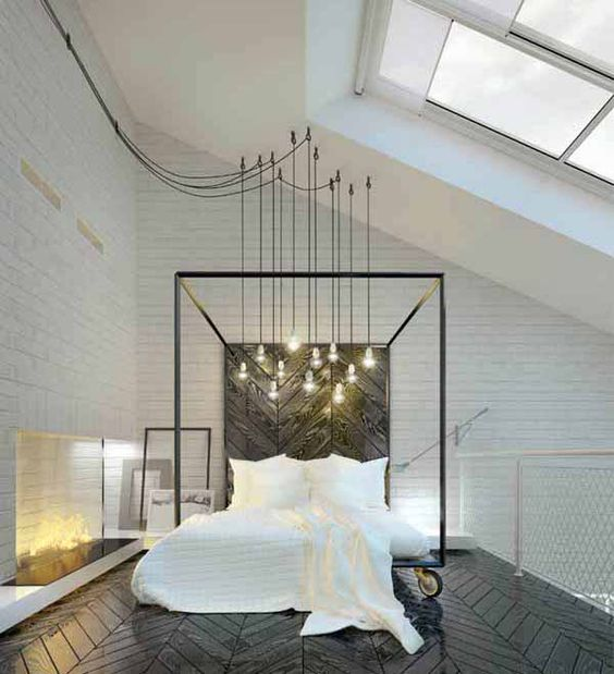 Master Bedroom with a bunch of exposed wire lamps right on top of the bed
