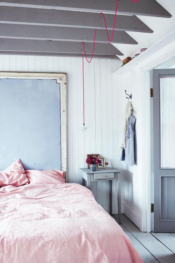 Pink exposed wire lamp in rose bedroom